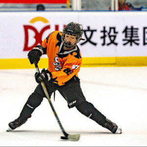 Image of my son playing hockey.