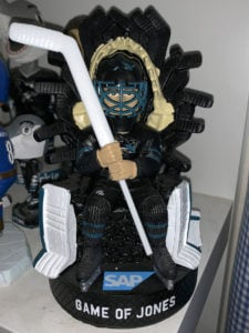 San Jose Sharks giveaway Game of Jones figure featuring goalie Jones sitting on a throne made of hockey sticks instead of swords (front view)