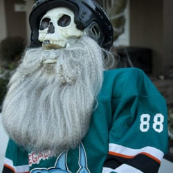 Megalodon #88 Chewie (ancestor of Burns) features his long, flowing beard and missing front teeth in this Halloween hockey game.