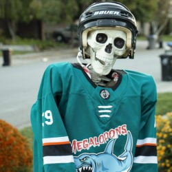 Megalodon #39 Creature (ancestor of Couture) is ready to score during this Halloween hockey game.