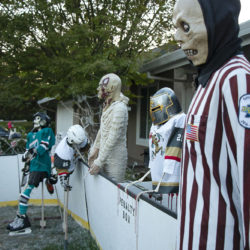 Scary ghoul refereeing the Halloween hockey game.