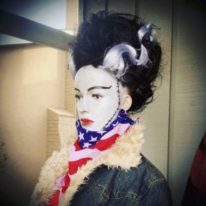 The Bride of Frankenstein in a denim jacket and a flag scarf.