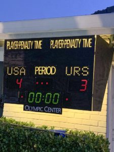 Scoreboard modeled after iconic artifact from 1980 Miracle on Ice hockey game showing the final score (USA 4 URS 3)
