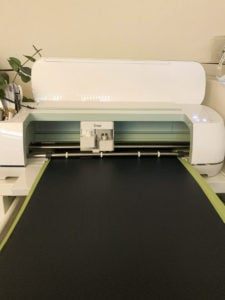 Cricut Maker desktop cutting machine cutting vinyl