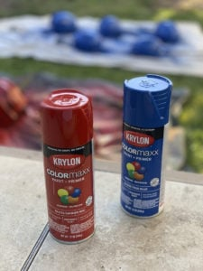 Krylon ColorMaxx Paint + Primer Spray paint containers used to paint helmets for the Halloween Miracle on Ice hockey game.