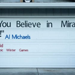 "Large quote from Al Michaels on garage door, ""Do you believe in miracles? Yes!"" from the 1980 Olympic Winter Games in Lake Placid."
