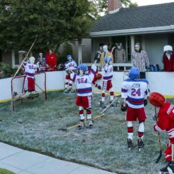 Skeleton team USA vs skeleton team USSR in the Halloween Miracle on Ice hockey game.