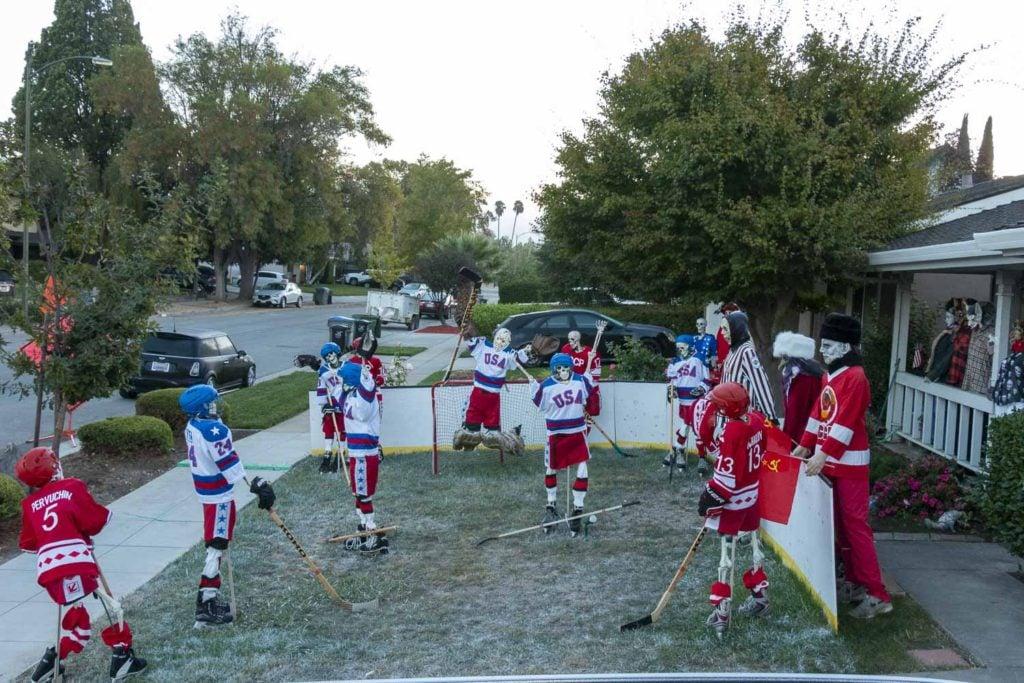 Skeleton team USA vs skeleton team USSR in the Halloween Miracle on Ice hockey game.