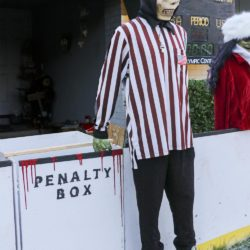 Scary ghoul with his silver whistle refereeing the Halloween Miracle on Ice hockey game.