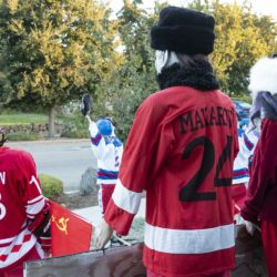 Traditional Halloween characters (a witch in a fancy faux-fur hat and Michael Meyers in a warm faux-fur hat and a Makarov jersey) cheer on skeleton Mikhailov and the Soviet team in the Halloween Miracle on Ice hockey game.