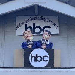 Ventriloquist dolls representing Ken Dryden and Al Michaels with the Halloween Broadcasting Company (hbc) call the Halloween Miracle on Ice hockey game on their skeleton-head microphones.