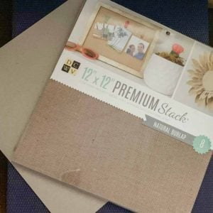 "12"" x 12"" Premium Stack of Natural Burlap and a piece of 12"" x 12"" chipboard."