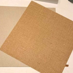 "12"" x 12"" piece of paper-backed burlap and a piece of 12"" x 12"" chipboard."