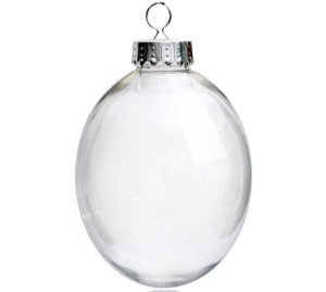 Clear plastic ornament in the shape of an egg used to make the Pouring Paint Easter Egg