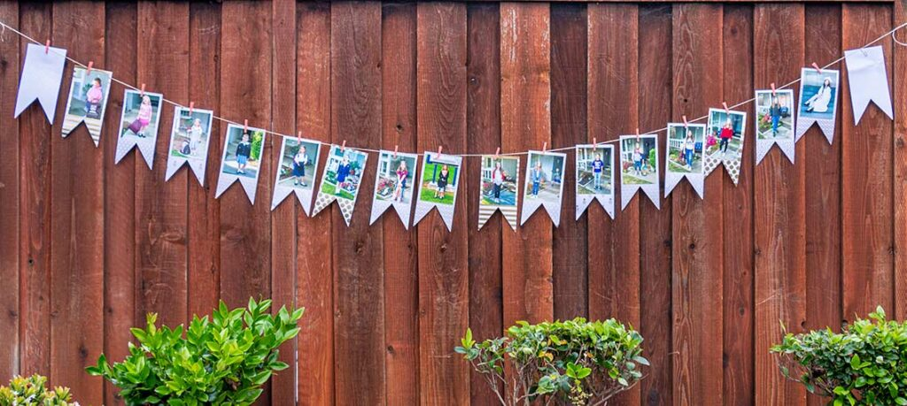 Graduation banner showcasing 1st day of school pictures mounted on white and gold cardstock hanging from twine by mini clothespins
