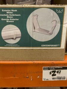 Close up the SKU and $2.47 price for the vinyl u-style external hooks at Home Depot for mounting the u-style gutter.