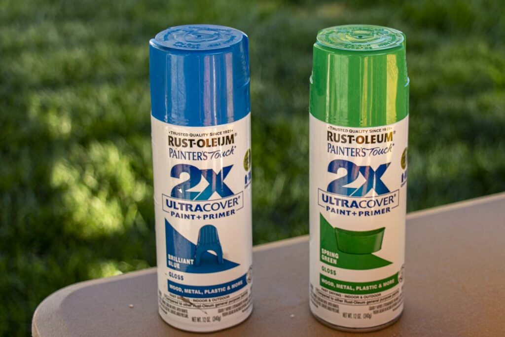 Two cans of Rust-Oleum Painter's Touch 2X UltraCover Paint + Primer in Brilliant Blue (Gloss) and Spring Green (Gloss). These colors were used for the gutter garden.