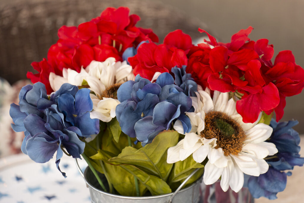 Red white and blue artificial flowers from Michaels used as a centerpiece on a patriotic table