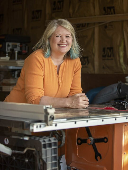 Image of Anne leaning on Ridgid Table Saw