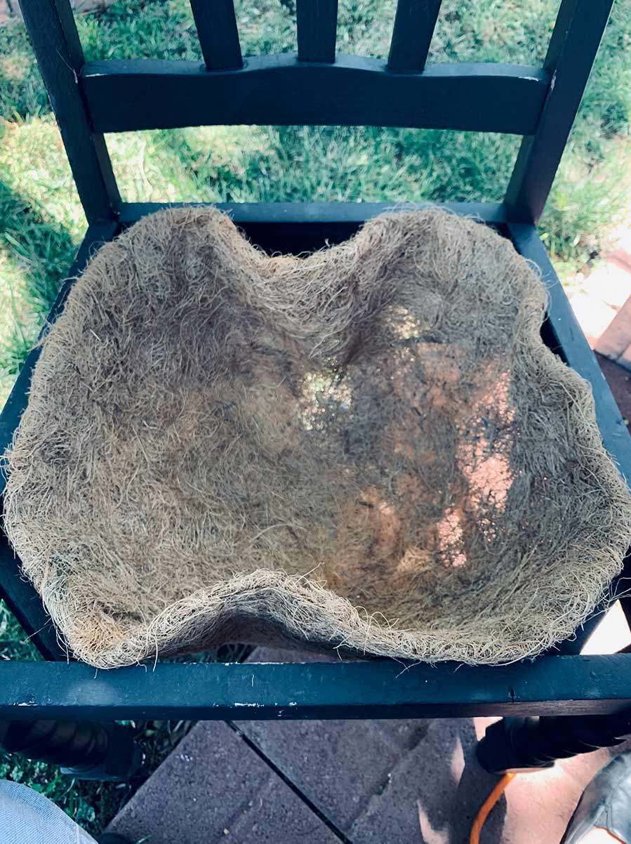 Coco fiber liner in the seat of an old chair.