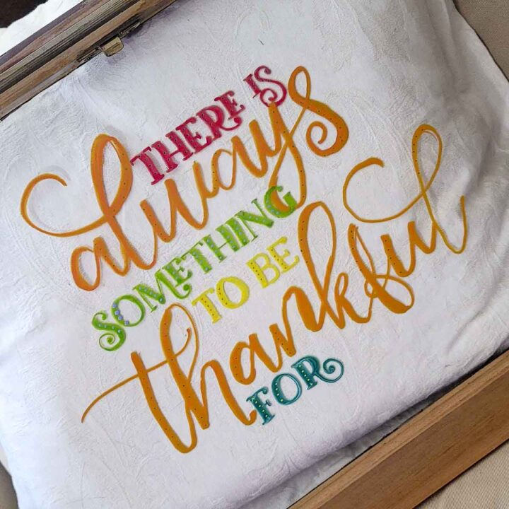 """Framed glass window painted with the phrase """"There is always something to be thankful for"""" using COLORSHOT premium markers"""