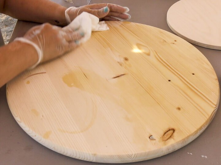 Applying wood conditioner to the wood serving tray
