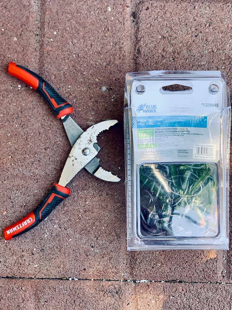 Pair of pliers next to a container of Blue Hawk #10 light duty decorative chain which will support the planter liner.
