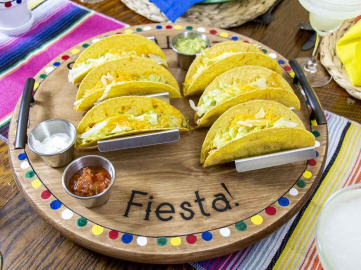 Taco Night Tablescape with lazy susan serving tray full of tacos.