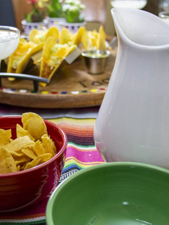 Taco Night Tablescape with festive table runner, colorful dishes, and serving platter