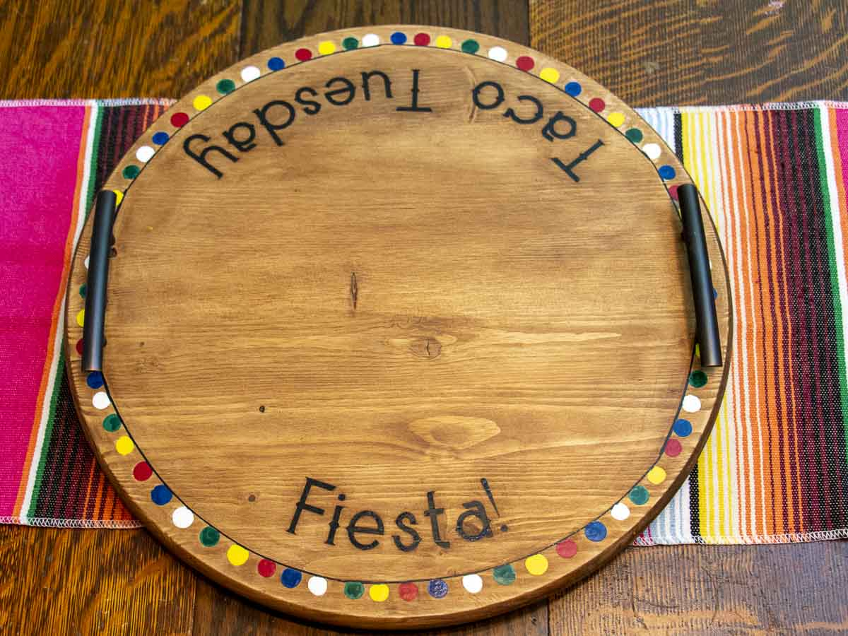 Round wood Taco Tuesday/Fiesta! Lazy Susan taco tray decorated with colorfully-painted pom poms around the edge.