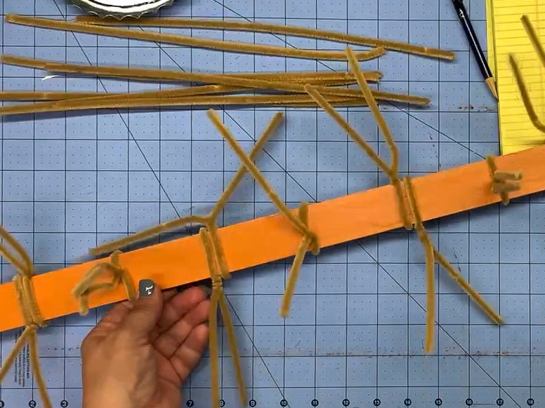 Pipe cleaners wrapped around a painted yardstick in a pattern every 3 inches (double, single, double, single, etc.)
