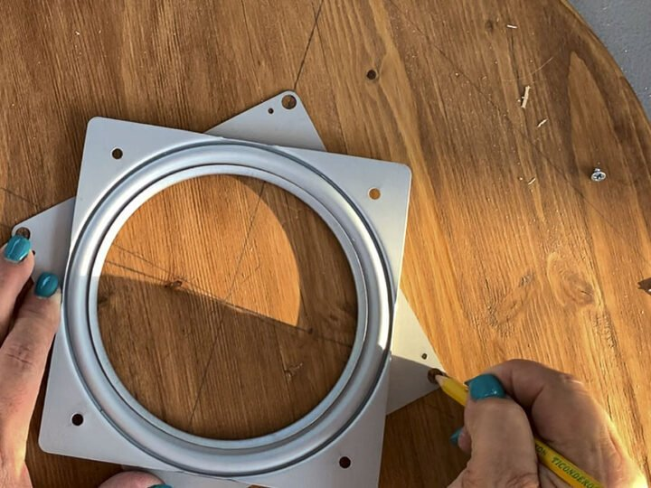 Marking the placement of the Lazy Susan swivel plate along two perpendicular lines on the underside of the top of the serving tray.