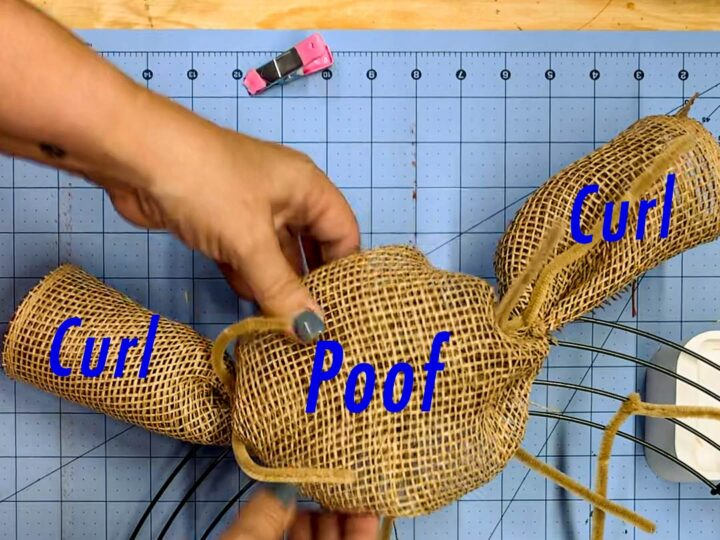 Parts of the curl and poof wreath made of rolled poly deco mesh (two mesh curls on the end surrounding a larger poof in the middle).