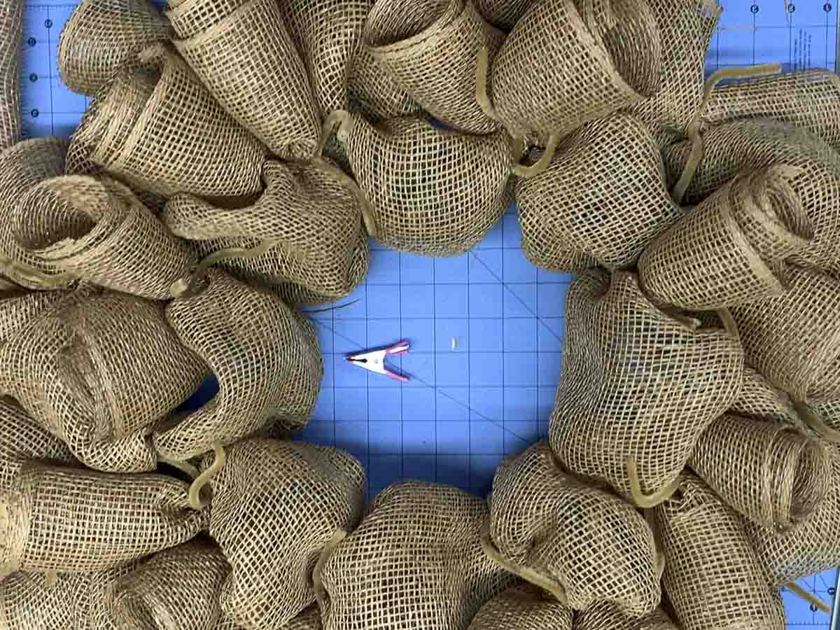 Poly burlap mesh wreath base consisting of poof and curls.