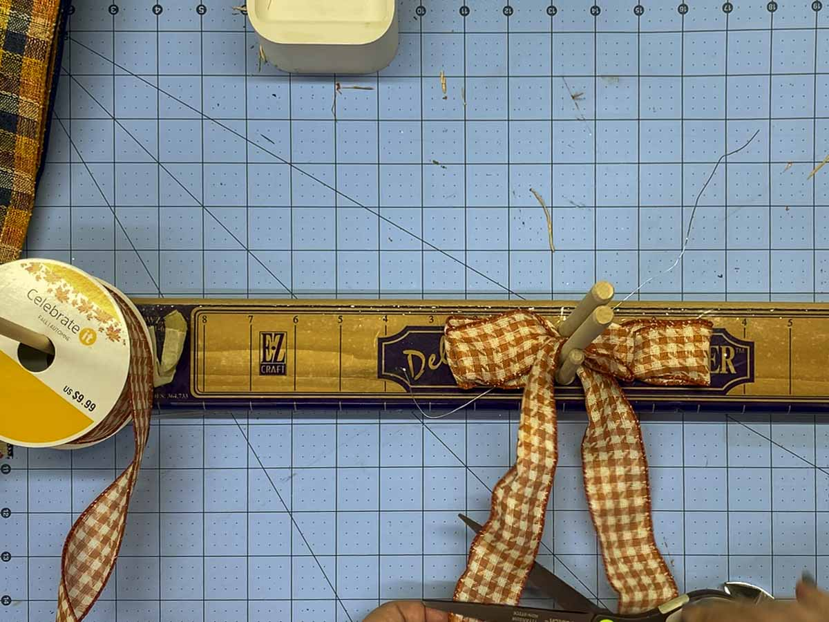 Forming a mini bow from ribbon using the Deluxe E-Z BowMaker